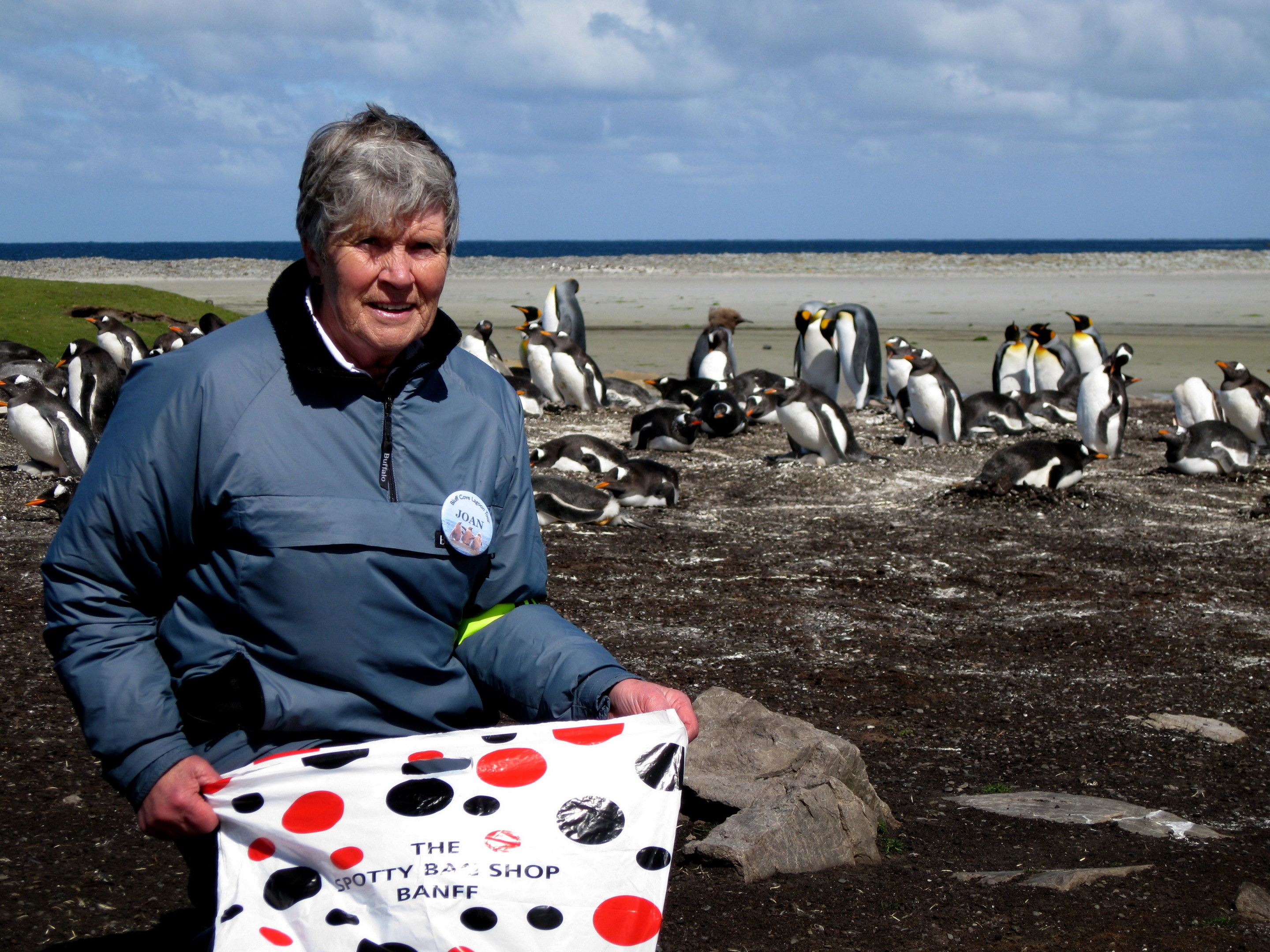 Joan Spruce on the Falkand Islands with a spotty bag
