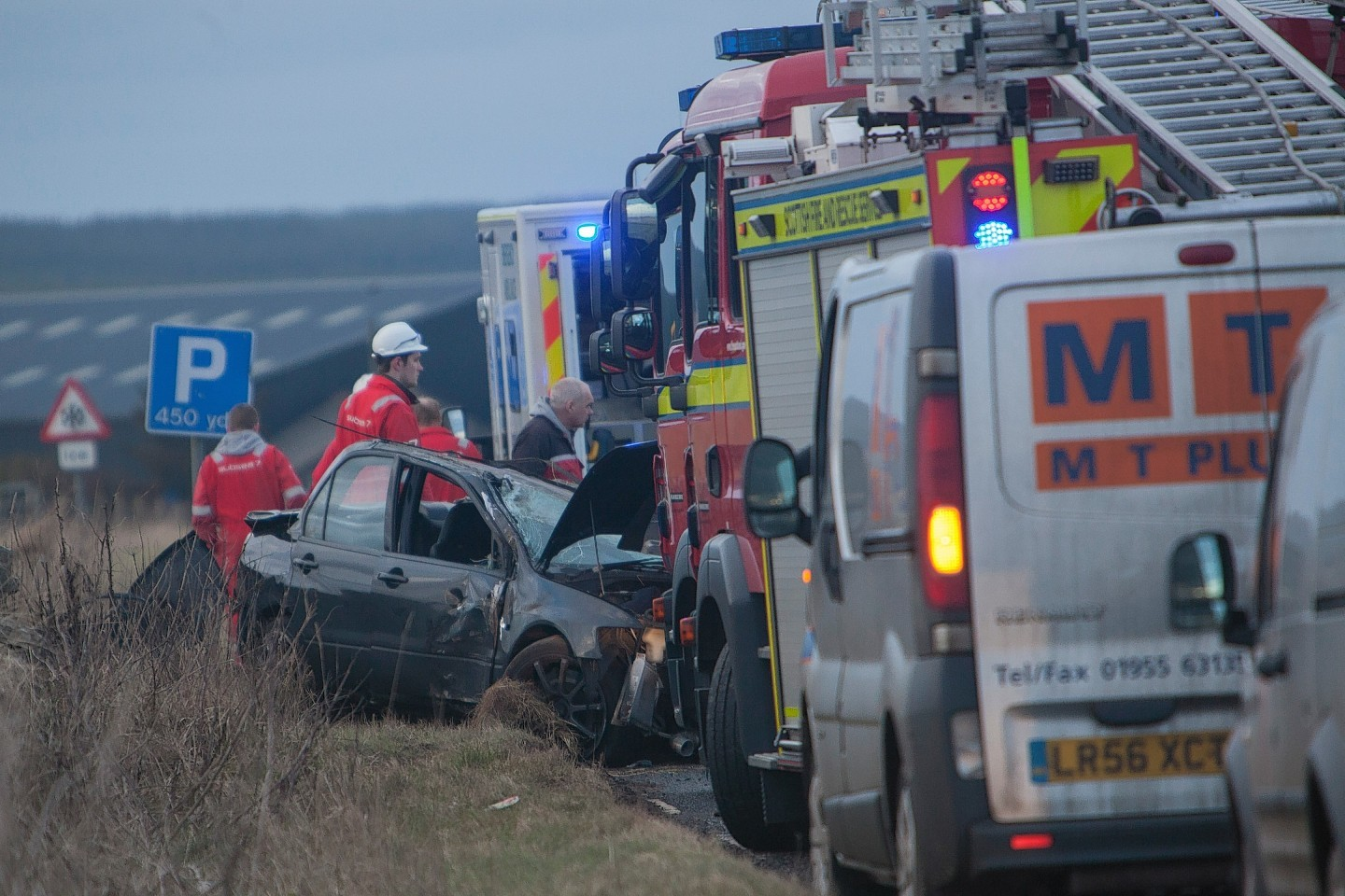 Emergency services at the scene of the accident on the A99