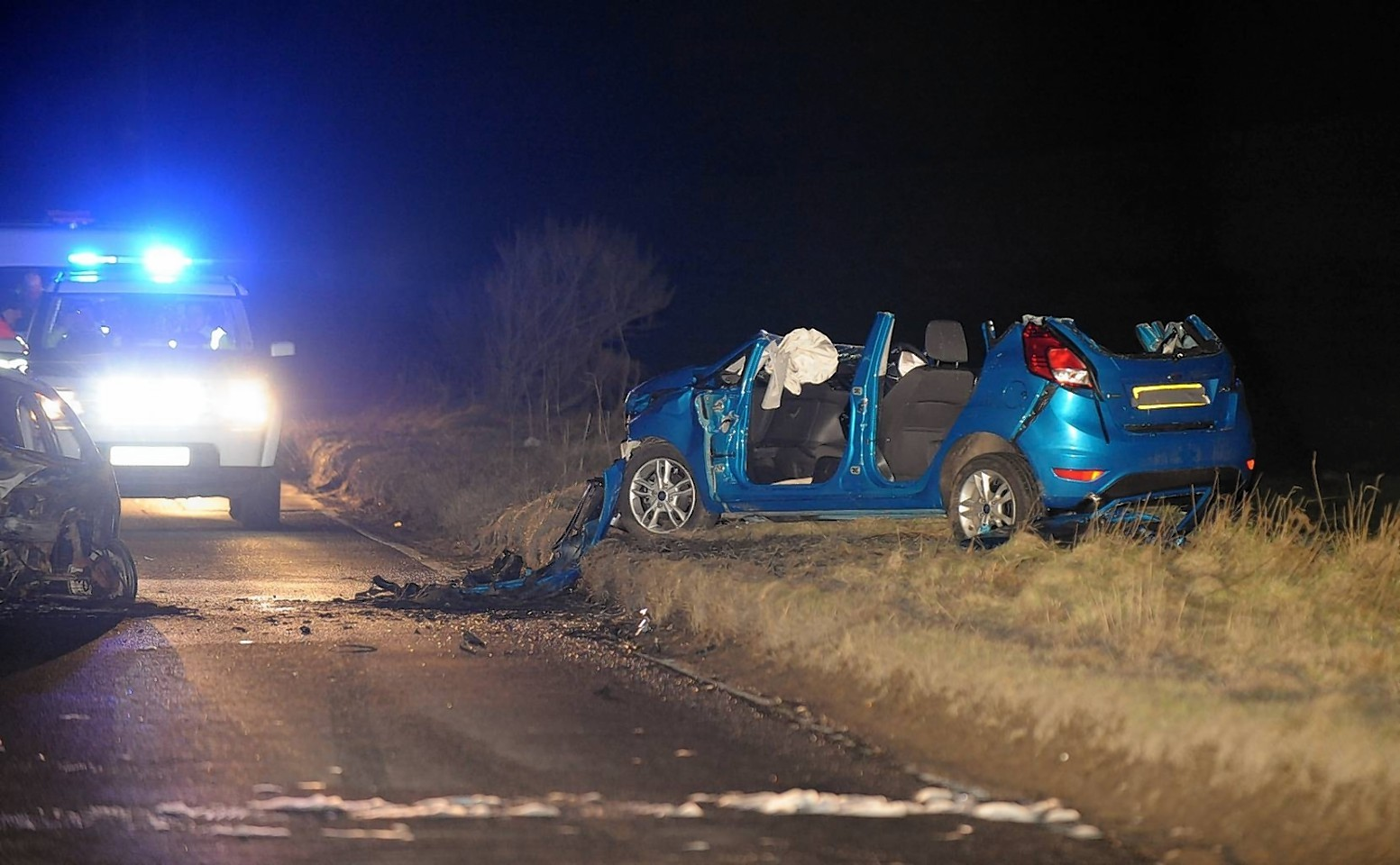 The Ka which caught fire at the scene of the crash on the South Deeside Road last night