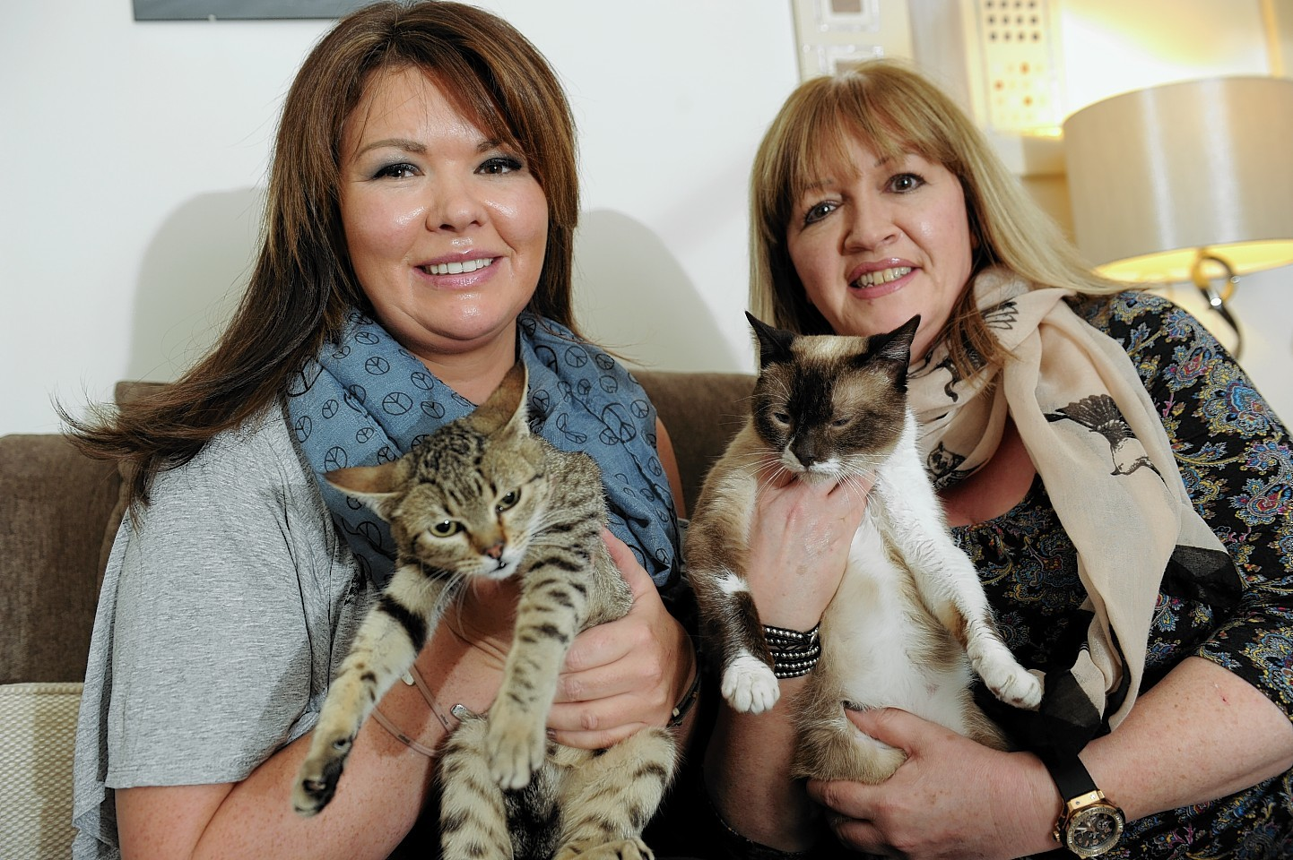 Helen Smith and Lynne Dickson with two of the cats