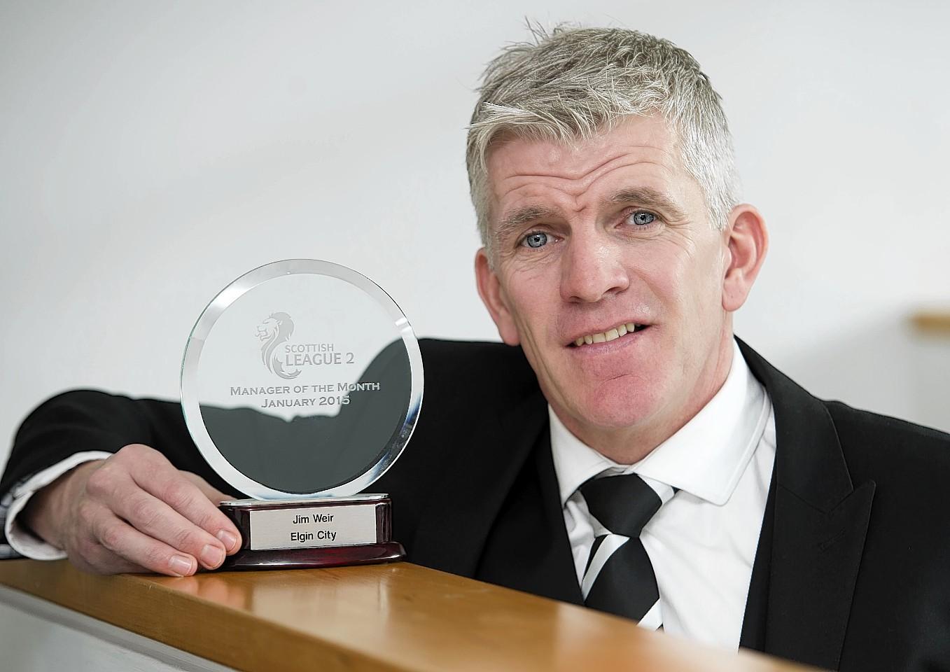 Jim Weir proudly displays his award