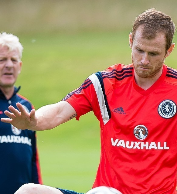 Scotland boss Gordon Strachan watches on as Reynolds trains for the national team