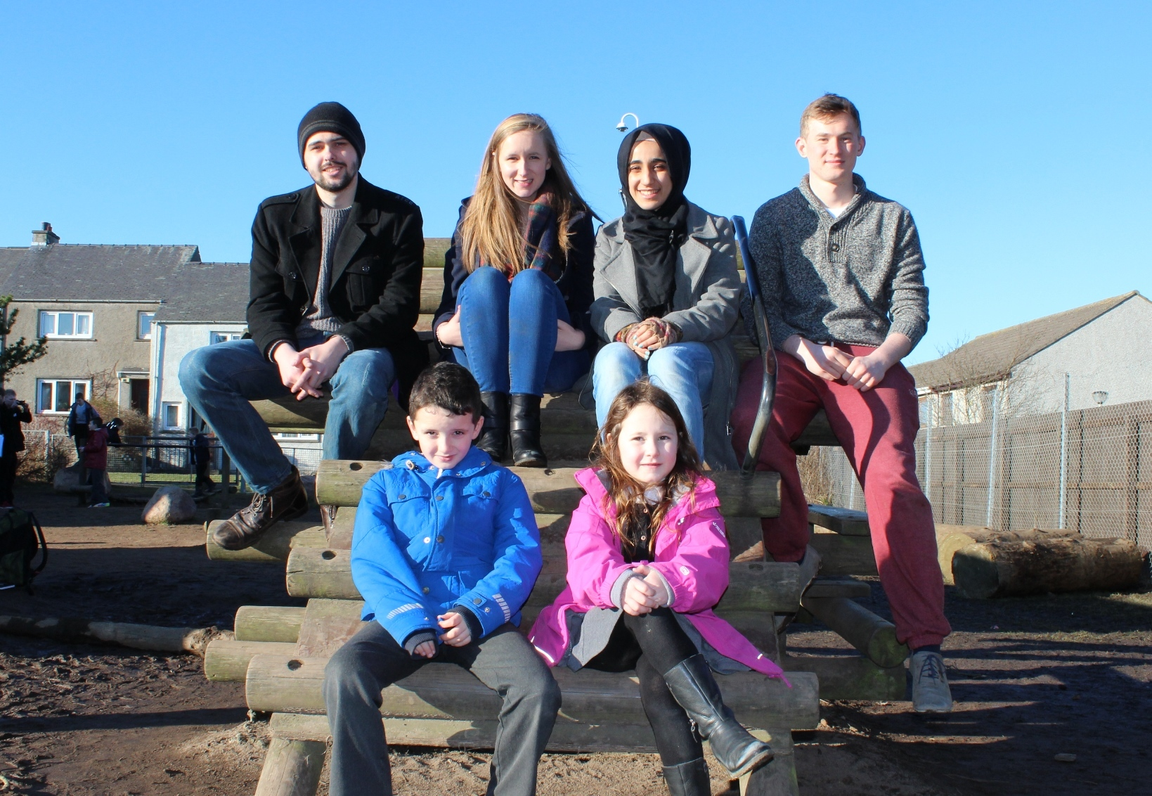 Students David Milne, Sophie Houston, Alaa Beruwien and Tom Perritt, with Portlethen youngsters Euan Brown and Lola McBeath.