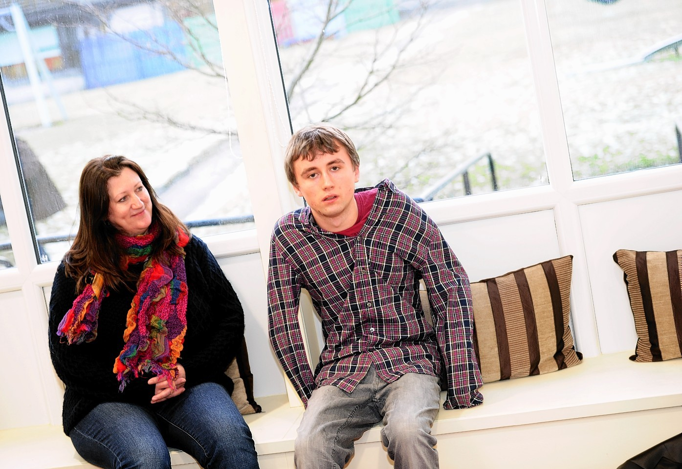 Elliot Brunty in Rowanlea House with his mum