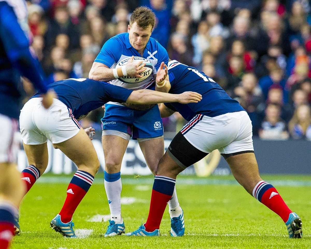Stuart Hogg is stopped in his tracks by French tackles at Murrayfield last year