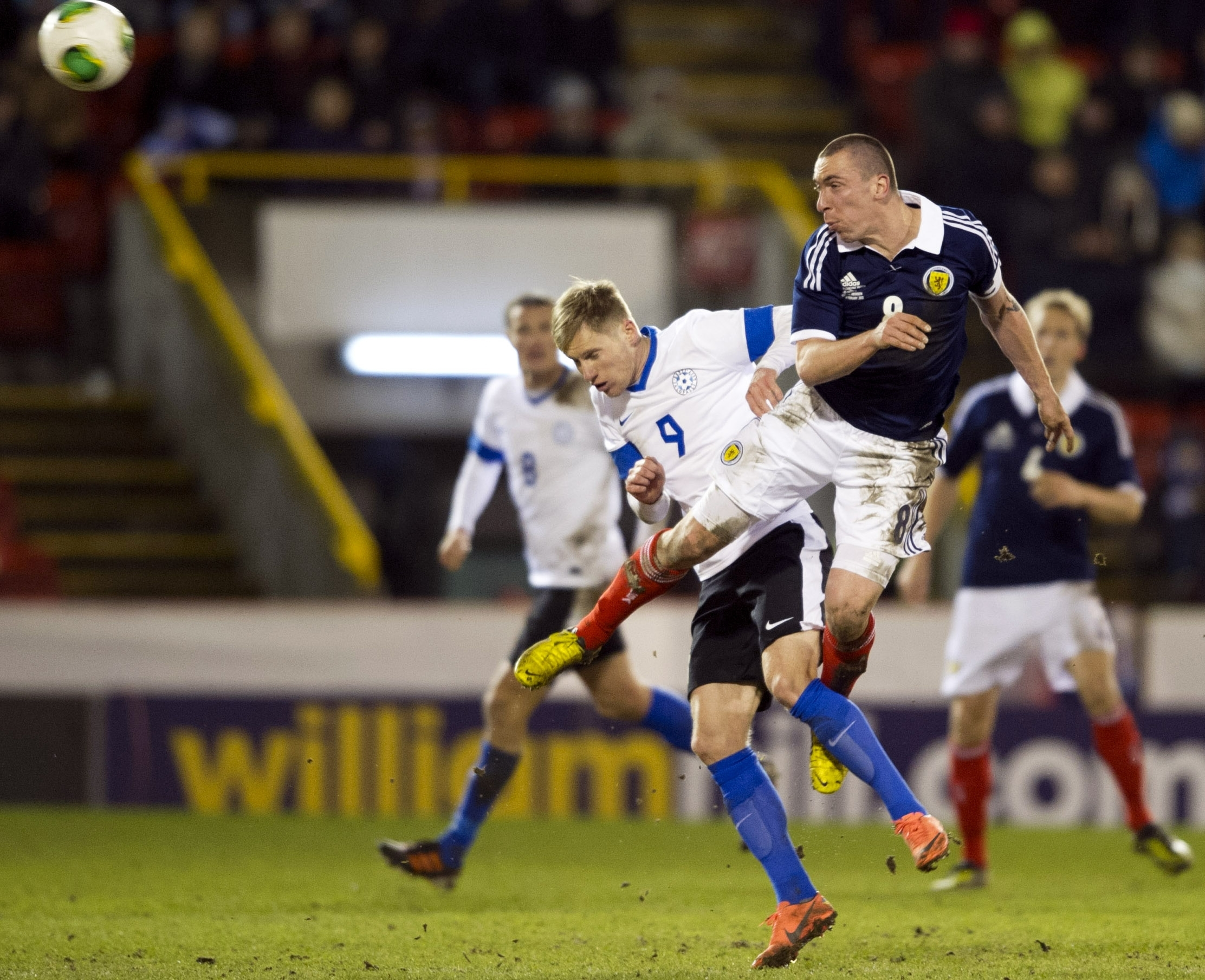 Tarmo Kink challenges Scott Brown for a header when Estonia played Scotland at Pittodrie