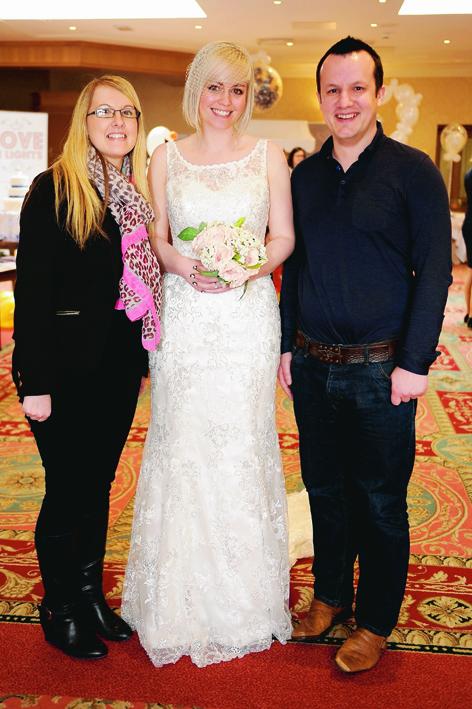 Katrina Laird, of Wedding Belles (centre) with Georgina Quin and her fiancee Martin Cumming