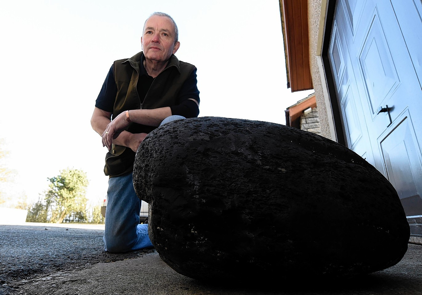 Ian Tait with the massive chunk of coal