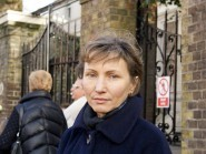 Marina Litvinenko stands beside tributes left outside the Russian embassy in central London after the shooting of Russian opposition politician Boris Nemtsov in Moscow