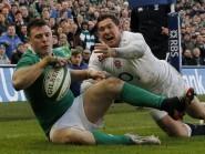 Robbie Henshaw, left, scores Ireland's try against England