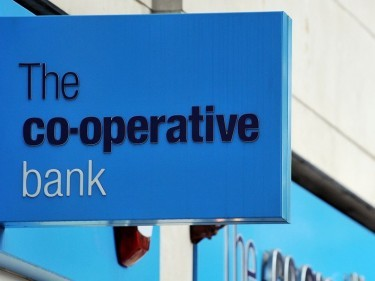 Pre-tax losses at the Co-operative Bank fell to £264.2 million in 2014 from £632.8 million the year before