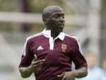Morgaro Gomis says winning the Championship title with Hearts is the pinnacle of his career