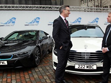Mike Hawes, SMMT chief executive, and MP Robert Goodwill with a BMW i8 and a Mercedes-Benz S-Class