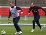 England captain Wayne Rooney, left, has urged people to give Harry Kane, right, some breathing space