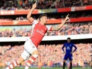Olivier Giroud celebrates his opener against Everton