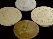 Four official portraits of the Queen as have appeared on coins in the UK during the Queen's 62-year reign (Royal Mint/PA)
