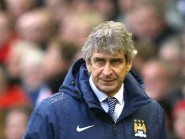 Manchester City manager Manuel Pellegrini insists they will not give up on the title despite defeat at Anfield.