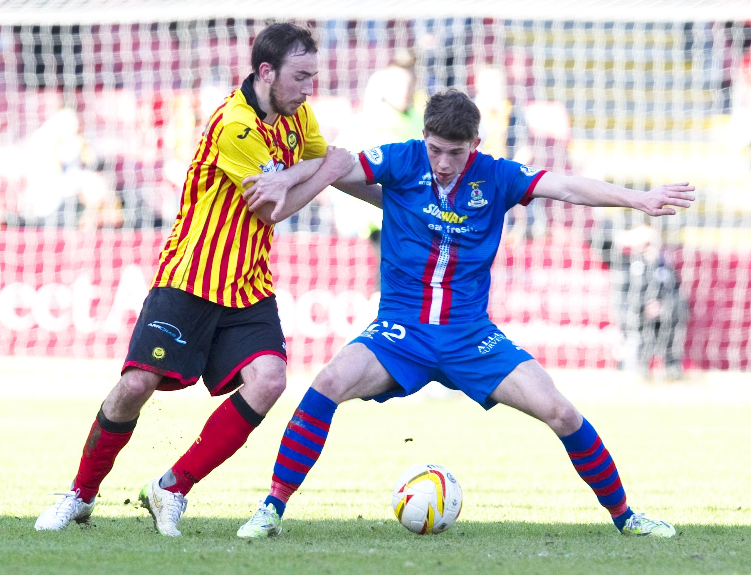 Stuart Bannigan and Ryan Christie battle for possession