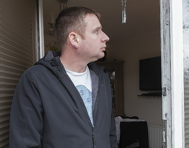 Donald Shearer looks at the damage to their home in Wick after the thieves broke in