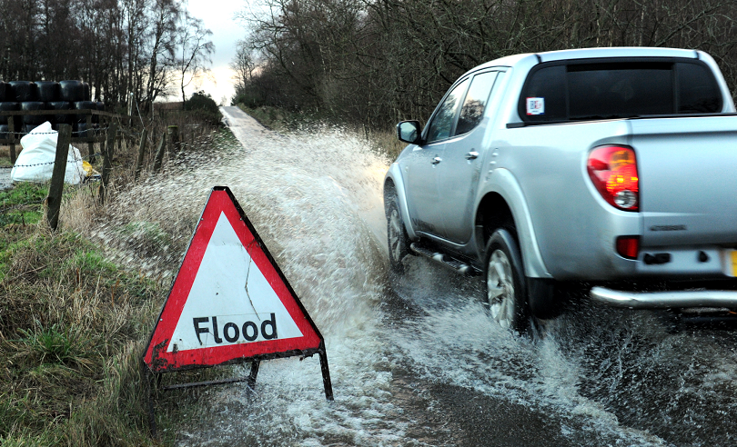 A driver negotiates surface water in Miltimber last January.