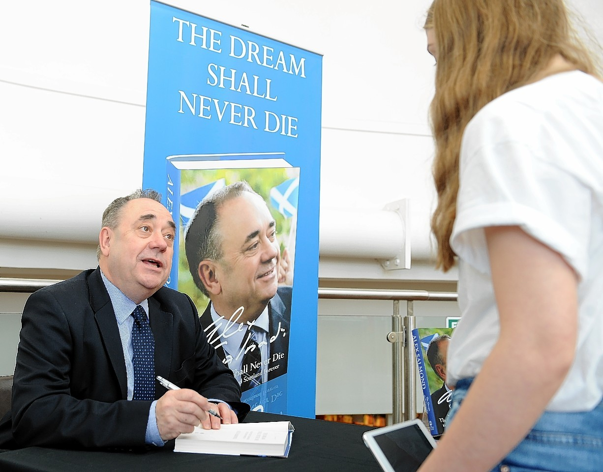 Alex Salmond signs his book for supporters in Waterstones in Inverness