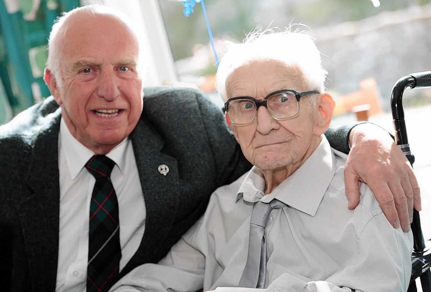 Former Gordon Highlander and Aberdeen Journals employee Arthur Robertson celebrates his 100th birthday  with his son Gordon