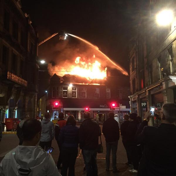 Fire crews battle the blaze on Academy Street, Inverness. Picture credit: Twitter user @Jamiefmacdonald