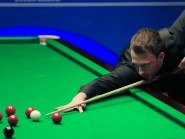 Judd Trump, pictured, will face Marco Fu in the second round