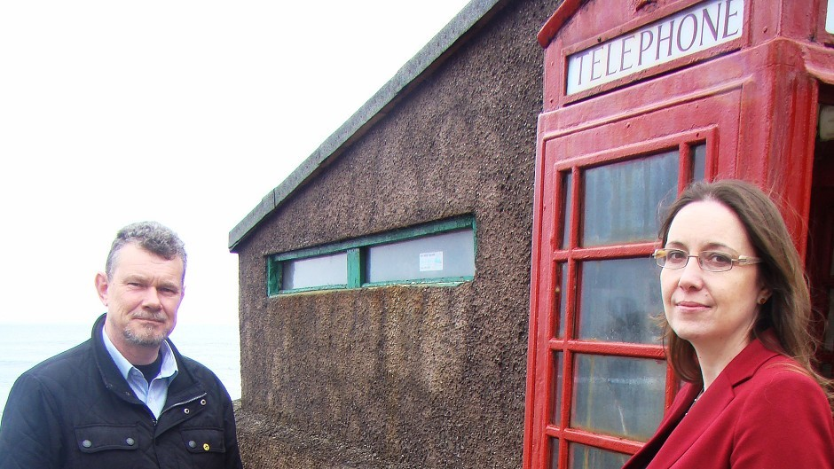 Banff and Buchan parliamentary candidate Eilidh Whiteford and Troup SNP councillor Ross Cassie at the phone box in Pennan, Aberdeenshire (SNP/PA)