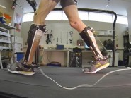 A man uses the boot-like exoskeleton, which has been developed to take the effort out of walking