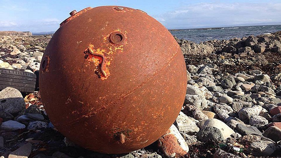 A suspected sea mine which washed up in the North Ayrshire town of Ardrossan