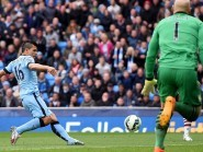 Sergio Aguero scores Manchester City's first goal against Aston Villa