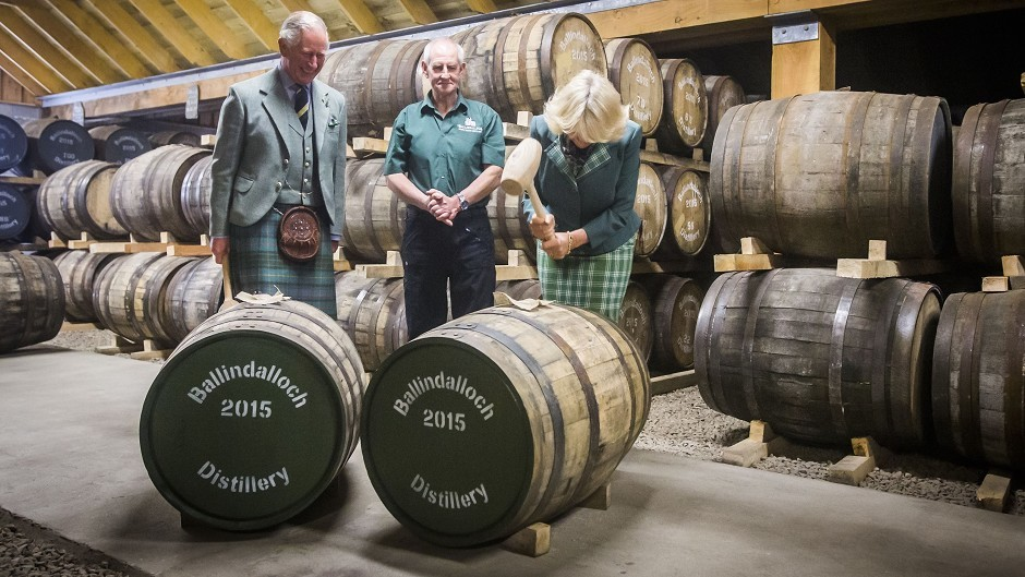 Charles and Camilla fitted bungs to two whisky casks during a visit to Ballindalloch Distillery in Aberdeenshire