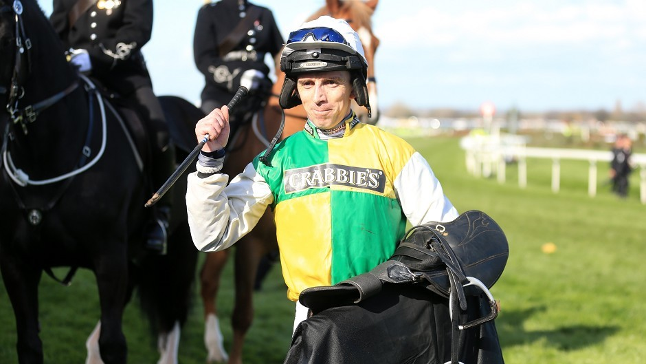 Jockey Leighton Aspell celebrates after victory in the Crabbie's Grand National Chase on Many Clouds