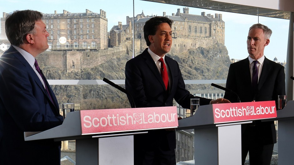 Labour leader Ed Miliband, centre, speaking alongside Ed Balls, left and Jim Murphy, has accused the Tories of sinking into personal abuse