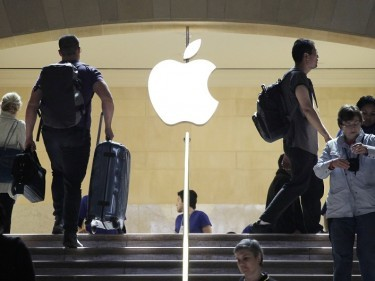 The company's continued surge in China meant 61 million Apple smartphones were sold (AP)
