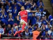 Alexis Sanchez celebrates the winner