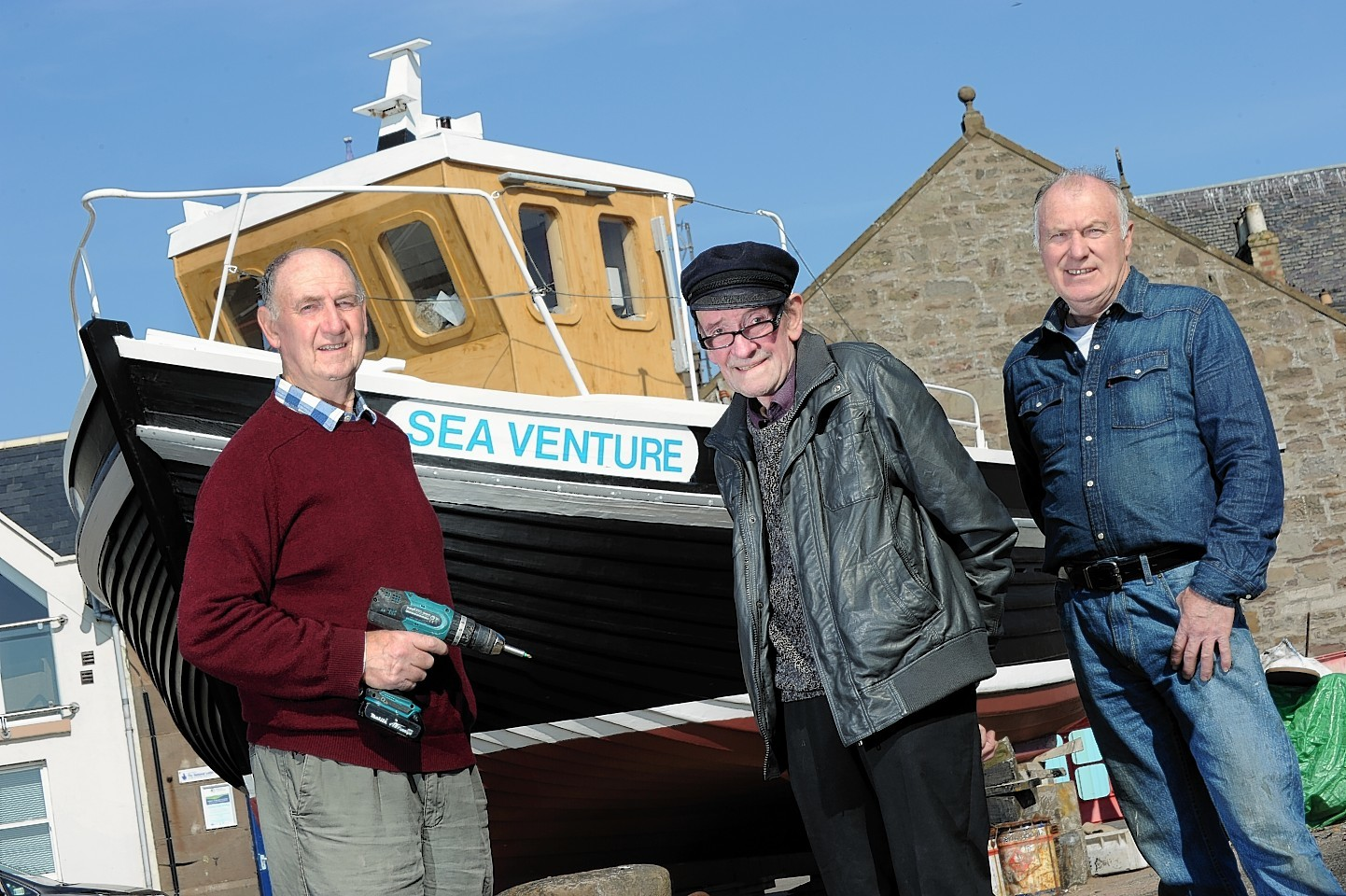 "Retired boat builders Tom Ritchie, Richard McBay and Lloyd Coates who have spent 10 years building a ""clinker"" which is now ready to go to sea"