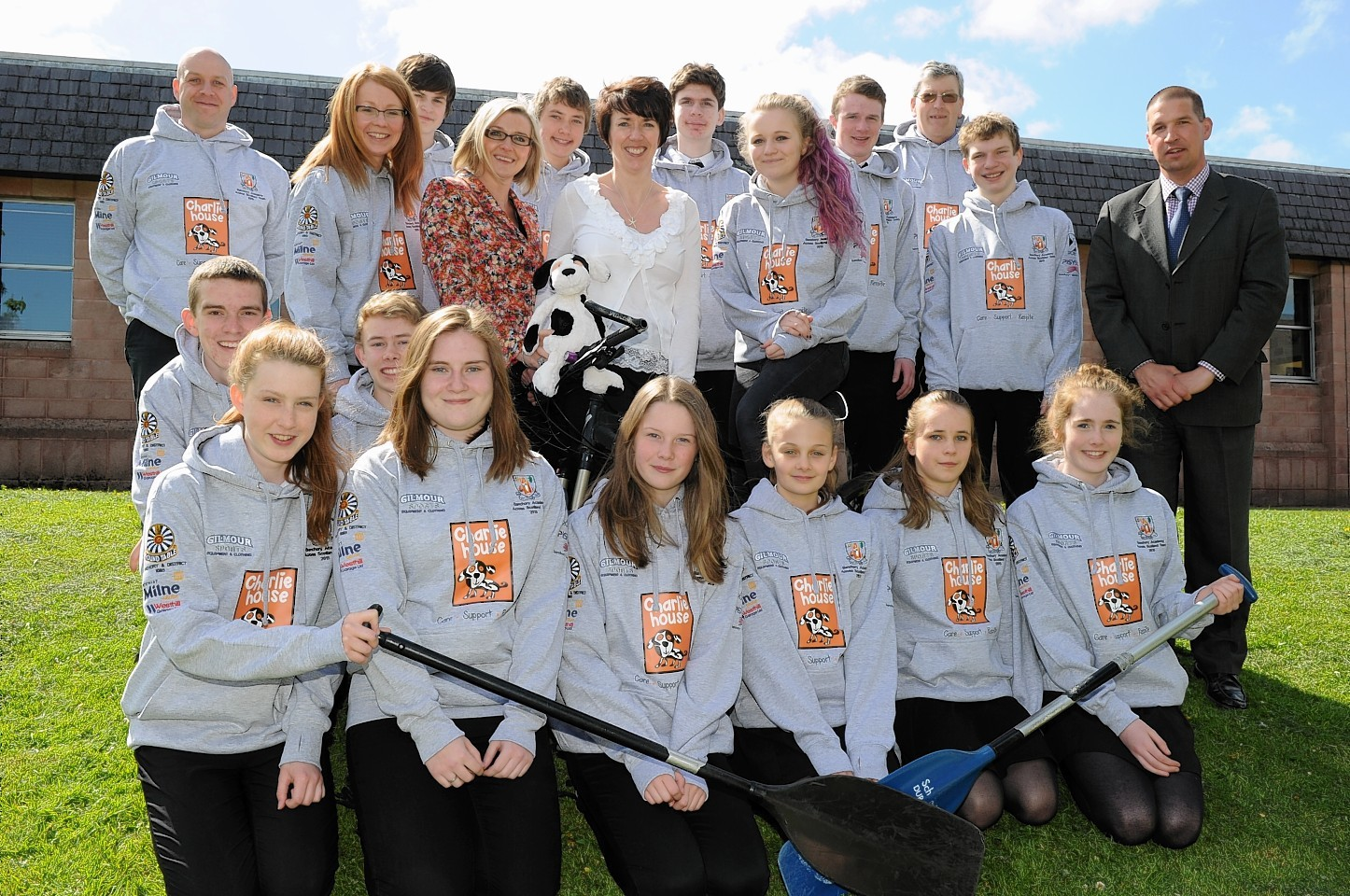 Charlie House's Tracy Johnstone with pupils and teachers. Deputy Head Colin Nicoll. Picture by Colin Rennie