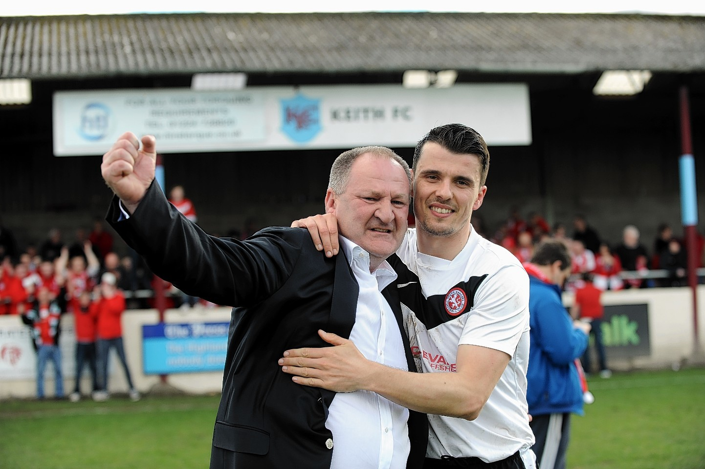 Ben Mackay celebrates with top scorer Steven Mackay,