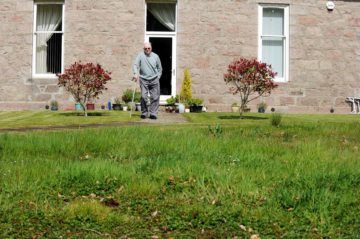 Bert Rendell is complaining about the ground in front of his home in Kingseat