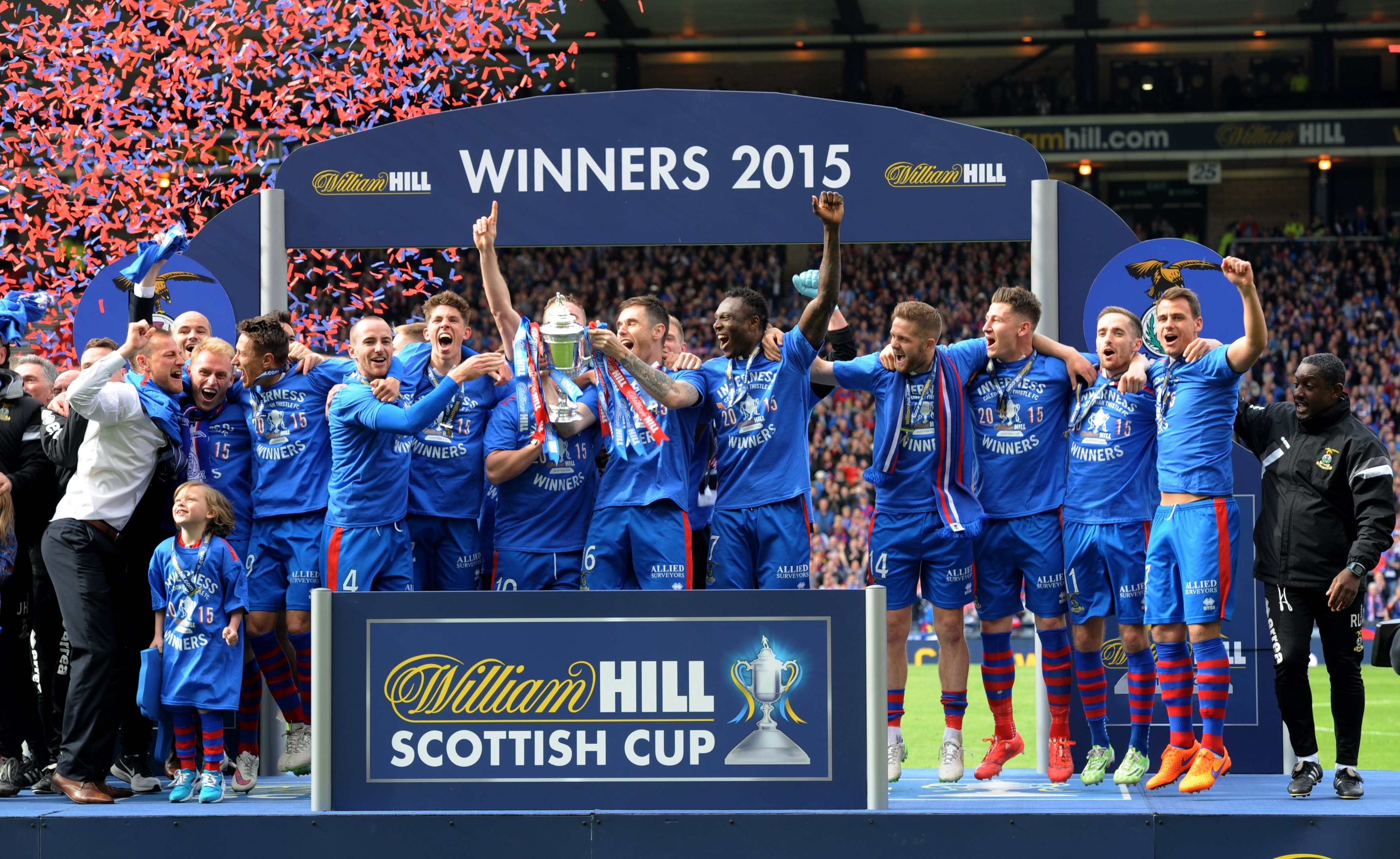 Now you see them... The Caley Thistle players celebrate with the Scottish Cup. Picture by Kenny Elrick