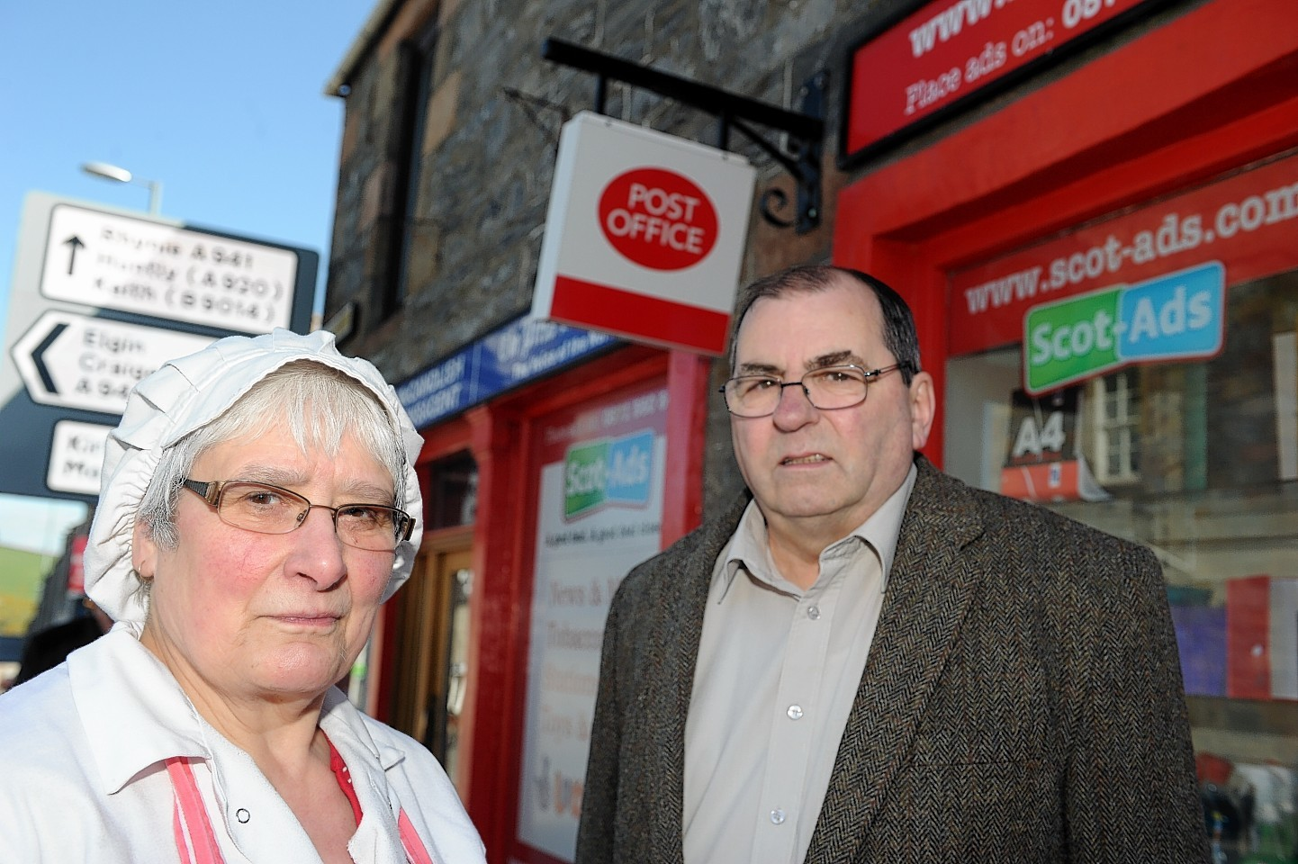 Bunty Campbell, left, chairman of Dufftown Community Council, and Moray councillor Mike McConnachie, right, outside Dufftown Post Office which closed suddenly. Picture by Gordon Lennox