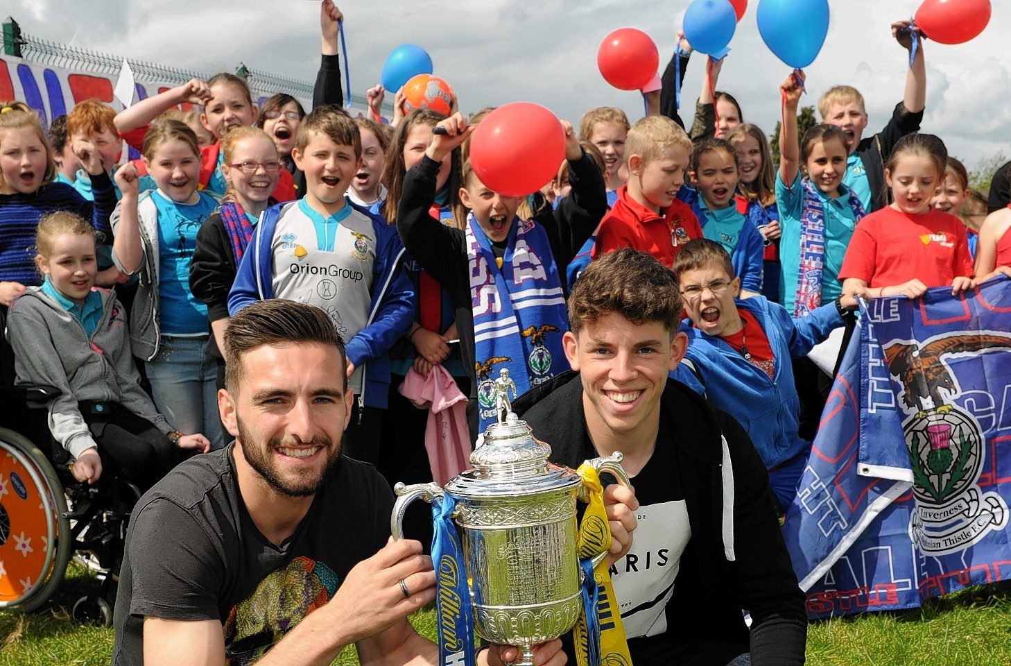 Graeme Shinnie and Ryan Christie with a local primary school and the Scottish Cup