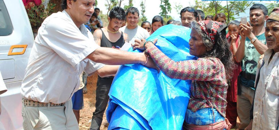 Associate of Himalayan Initiatives - Kumar Karki - handing out aid in one of the affected villages in Nepal