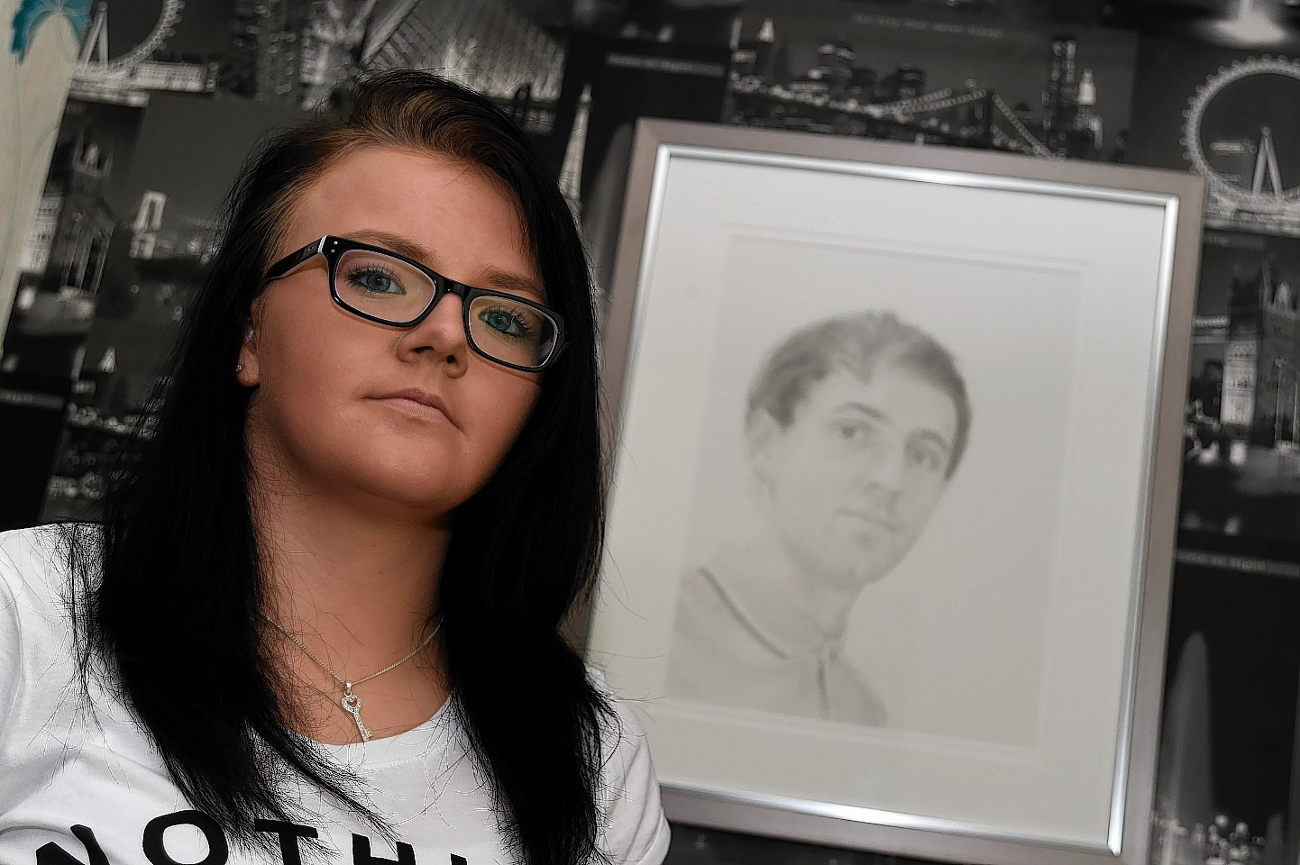 Nicola Shand with a portrait of her brother Shaun Ritchie