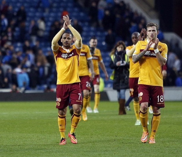The Motherwell players applaud their fans after their Ibrox first leg triumph