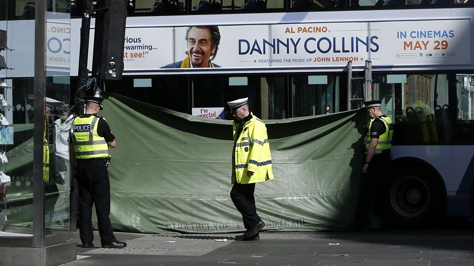 Police erected drapes around the scene of the incident at the corner of Argyle Street and Queen Street in Glasgow city centre