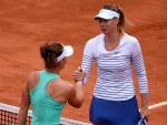 Maria Sharapova, right, shakes hands with Samantha Stosur after beating her in straight sets at Roland Garros