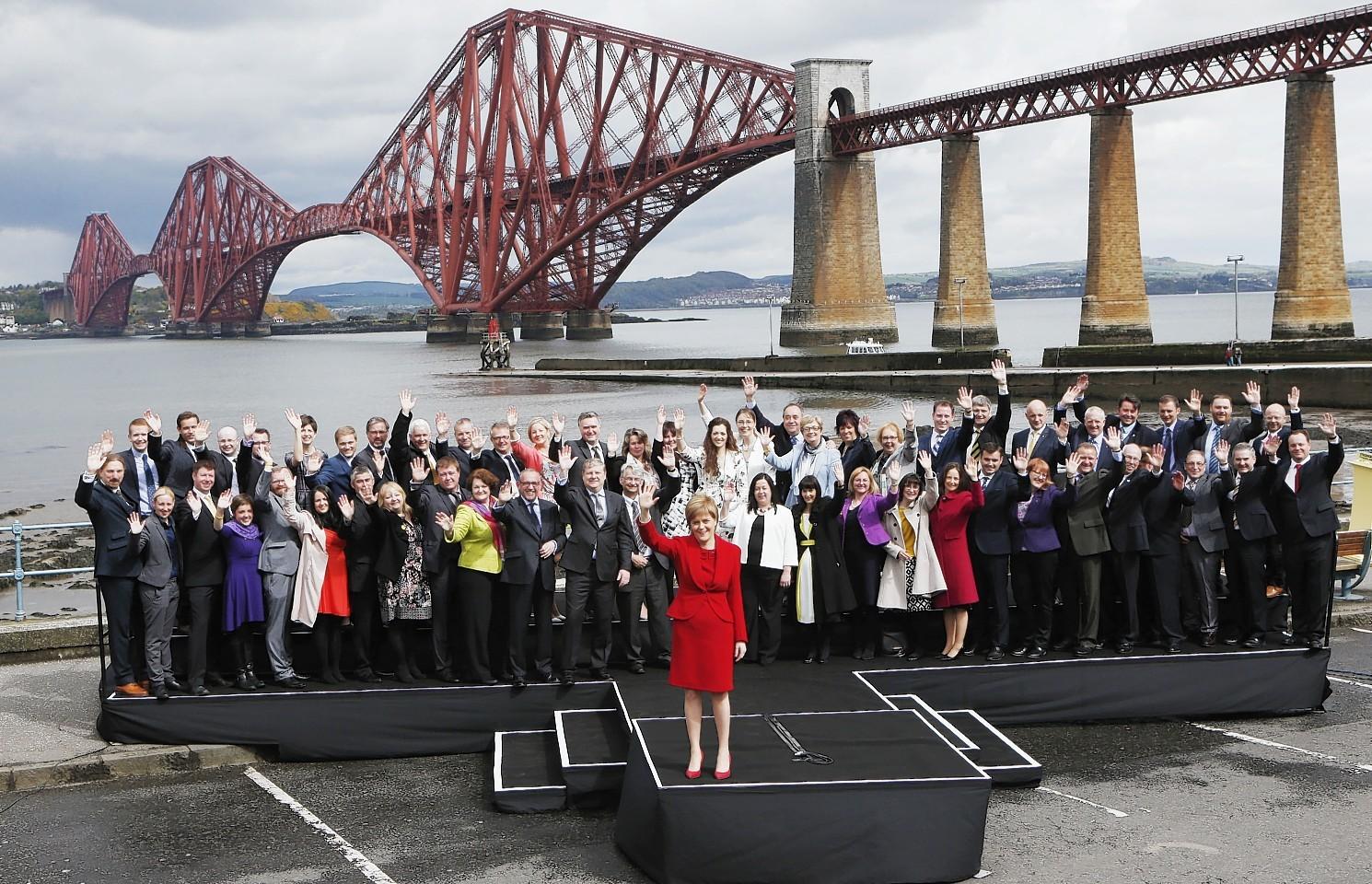 Nicola Sturgeon with the SNP's 56 MPs